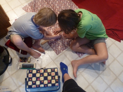Sawyer and Parks working on the quilt