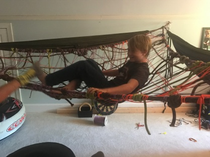 He also spent his free time building this space net in his room. He got the idea from this web site. https://www.mnn.com/lifestyle/eco-tourism/blogs/highliners-base-jumpers-rig-massive-aerial-space-net-over-moabs-red