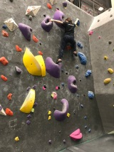 Sawyer bouldering after practice