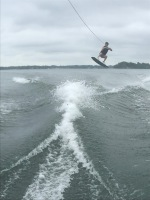 Sims playing on the wakeboard