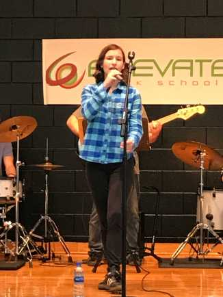 Sawyer singing at the fall festival