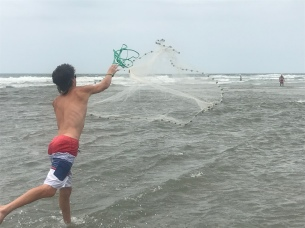 Playing at the beach-cast net