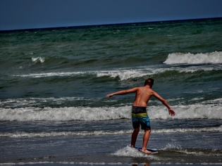 Playing at the beach-skim boarding