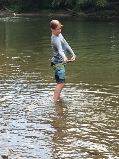 Skipping rocks in the river