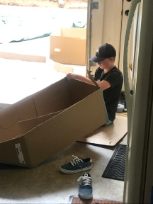 Making his cardboard boat