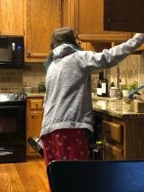 Sawyer emptying the dishwasher